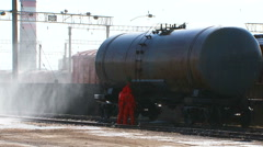 Two Workers In Protective Clothes Standing At Fuel Tank Stock Footage