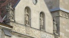 Four sculptures of saints on the Saint Michael cathedral in Alba Iulia - stock footage