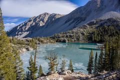 USA, California, Eastern Sierra, Mountain landscape with glacier lake and pine Stock Photos