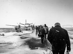 Sweden, Kalmar, Kalmar Airport, Passengers boarding small airplane in winter - stock photo