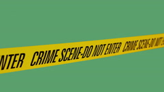 """Tape Barrier """"crime scene - do not enter"""" in the wind moving back and forth on g Stock Footage"""