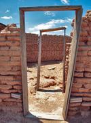 USA, Arizona, Yuma County, Aztec, Doorway frames of abandoned brick building Stock Photos