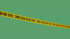 """Tape Barrier """"crime scene - do not enter"""" in the wind moving back and forth on g - stock footage"""