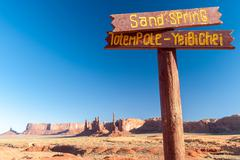 USA, Arizona, Monument Valley, Wooden sign post in desert - stock photo