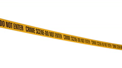 """Tape Barrier """"crime scene - do not enter"""" in the wind moving back and forth on w - stock footage"""