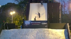 Acrobatic display by ski and snowboard champions Stock Footage
