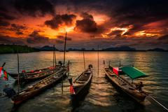 Thailand, Phang Nga, Fishing boats in sea - stock photo