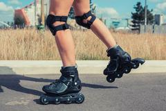 Woman rollerblading on sunny day - stock photo