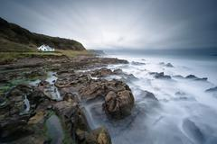 Ireland, Ballycastle, House by sea - stock photo