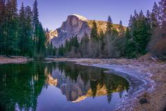 USA, California, Yosemite National Park, Half Dome reflecting in water - stock photo