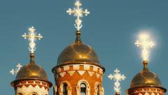 The light rays reflect from the golden cross on the dome of the Christian church Stock Footage