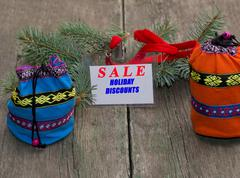 Coniferous branch, blue and orange bag, label with an inscription Sale Stock Photos