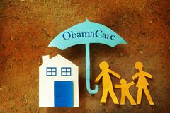 Family Obama Care umbrella Stock Photos