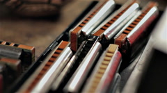 Set of mouth accordions on the table Stock Footage