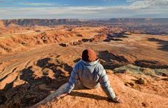 USA, Utah, Canyonlands National Park, Hiker looking at Buck Canyon Stock Photos