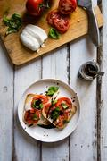 View of mini caprese pizza - stock photo