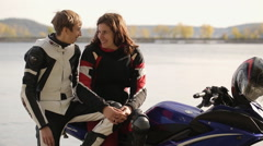 Young couple of lovers haviing fun and talking on motorcycle Stock Footage