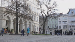 People walking in the middle of a European city time lapse Stock Footage