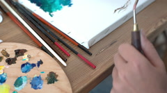Artist working on an oil painting. View of color fairy tale tree. Stock Footage