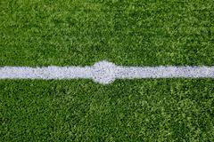 Straight white chalk line marking on grass background. Stock Photos
