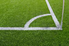 Stock Photo of Corner boundary markings of grass soccer field