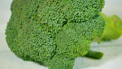 Broccoli and green beams on the white wooden table. Slider shot. Stock Footage