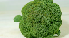 Broccoli on the white wooden table. Rotation. Stock Footage