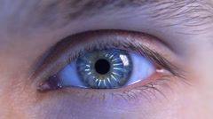 The man's eyes reflect the moving light rays. Eye iris and pupil macro - stock footage
