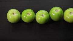 Pan over a variety of tomatoes Stock Footage