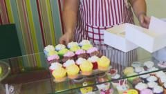 Process of making delicious cupcakes in a bakery shop Stock Footage