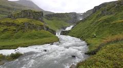 ICELAND Mjoifjoerdur waterfall Wasserfall tourist person Stock Footage
