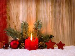 Christmas decoration und Advent candle. Stock Photos