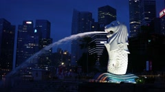 Merlion fountain sprays a continuous jet of water from its mouth Stock Footage
