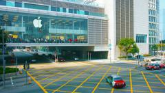 Enormous Apple store in building wing which spans major urban street Stock Footage
