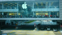 Long line of customers, waiting to enter a huge Apple store in Hong Kong Stock Footage