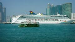 SuperStar Virgo, flagship of Star Cruises' Asian fleet, docked in Hong Kong Stock Footage