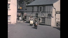 Vintage 16mm film, 1965, Wales, village life shop and motorbikes Stock Footage