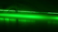 Continuous wave green laser propagates through the optical components. - stock footage