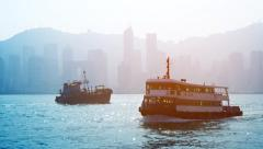 Boat traffic in a busy Hong Kong shipping channel on a hazy day. Stock Footage