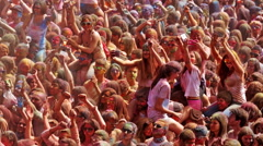 Many happy dirty people at Festival de los colores Holy at Barcelona - stock footage