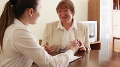 Senior woman answer questions of social worker at home Stock Footage