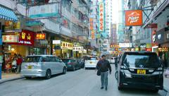 Western and Chinese businesses on a busy commercial street in Hong Kong Stock Footage