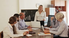 View at working meeting with diagram at background Stock Footage