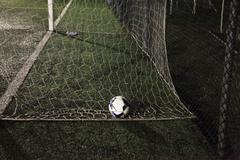 Italy, Ball of soccer in soccer goal Stock Photos