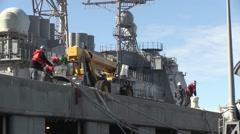 USA Virgina Norfolk, November 2015, Harbour Crew Solve Ropes - stock footage