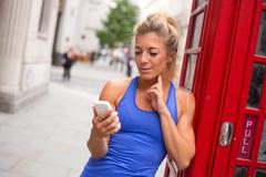 sporty girl in london checking her heartrate - stock photo