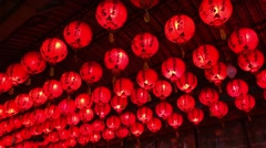 Red lantern hanging from the ceiling Stock Footage