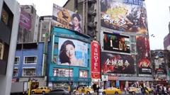 Taipei major traffic intersection near ximending Stock Footage