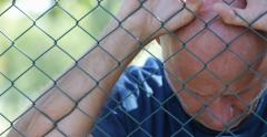 Sad Men Beside Metal Fence Border Protect Wall Suffering Depressed Stressed - stock footage