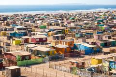 Chile, High angle view of multi colored huts on beach Stock Photos